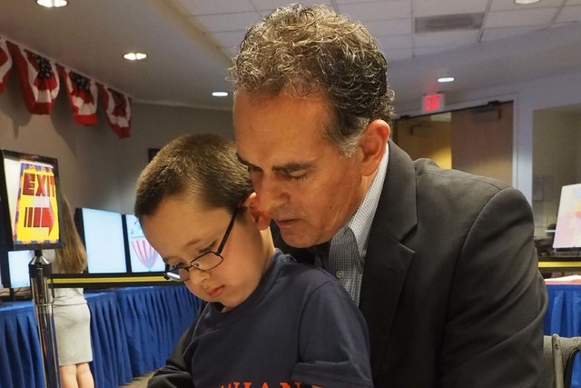 Danny Tarkanian files to run for the 3rd Congressional District seat while his son Jerry, 6, sits on his lap at the Clark County Government Center in Las Vegas, Thursday, March 10, 2016. Jerry Hen ...