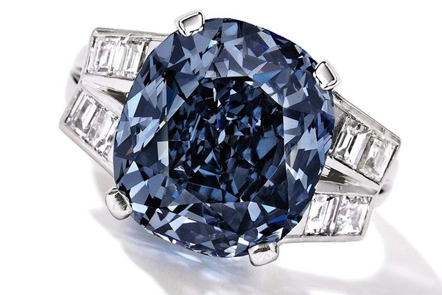This undated photo provided by Sothebys shows the 9.54 carat blue diamond ring worn for decades by child star-turned-ambassador Shirley Temple, which is going up for auction on April 19, 2016 by S ...