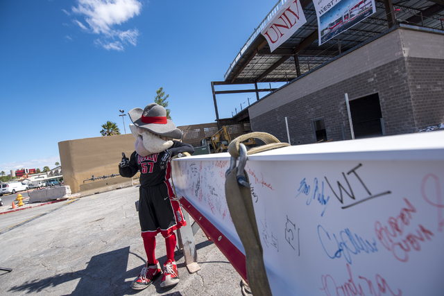 Hey Reb poses for a photo next to the steel beam signed by event attendees at the Thomas & Mack topping-off ceremony at UNLV in Las Vegas on Tuesday, March 22, 2016. Joshua Dahl/Las Vegas Revi ...