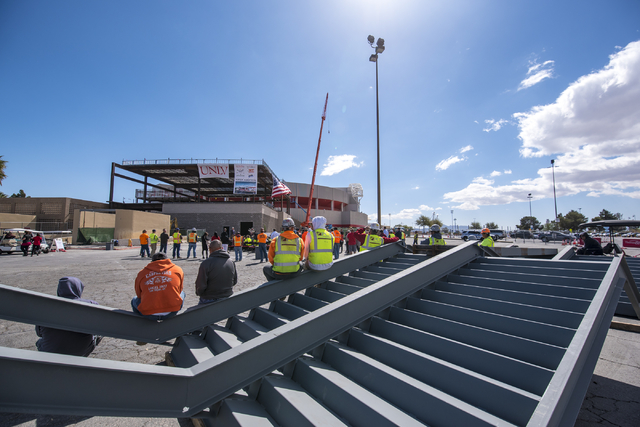 Construction workers look on during the Thomas & Mack topping-off ceremony at UNLV in Las Vegas on Tuesday, March 22, 2016. Joshua Dahl/Las Vegas Review-Journal