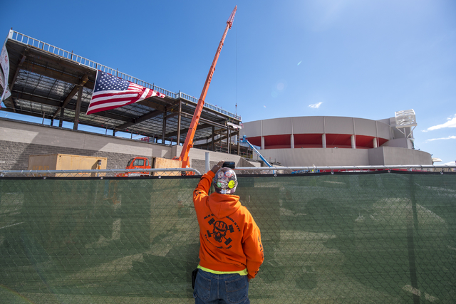 Gerald Wilson records a video on his phone as workers raise the steel beam into place during the Thomas & Mack topping-off ceremony at UNLV in Las Vegas on Tuesday, March 22, 2016. Joshua Dahl ...