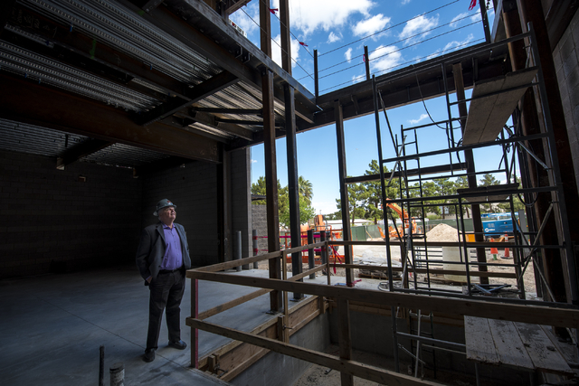 Clark County Commissioner Steve Sisolak looks at the inside of the new addition to the Thomas & Mack Center during the topping-off ceremony at UNLV in Las Vegas on Tuesday, March 22, 2016. Jos ...