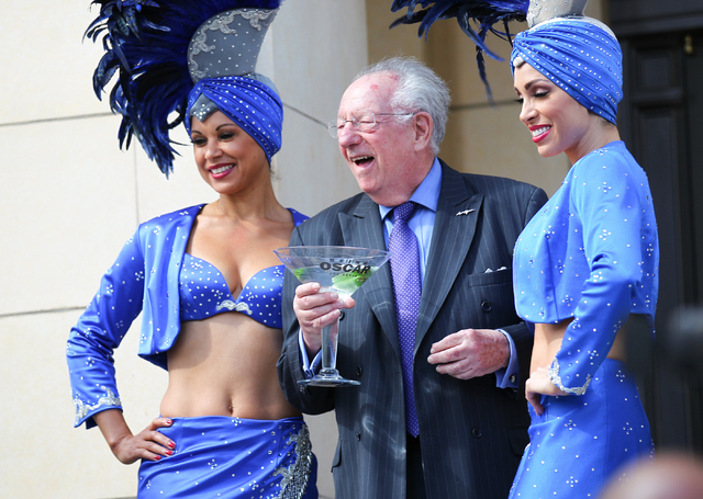Former Las Vegas mayor Oscar Goodman stands with his showgirls before the start of the inauguration of a new exhibition dedicated to former Las Vegas sheriff Ralph Lamb as part of a National Touri ...