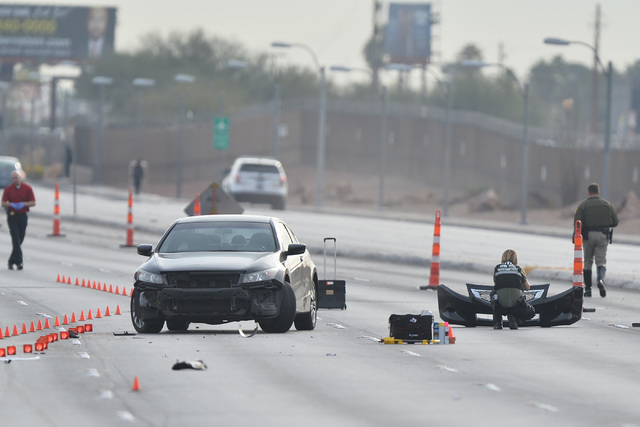 A crime scene investigator take a photo of the front of a car involved in a fatal accident on Tropicana Avenue near Koval Lane on Thursday, Mar. 3, 2016. Brett Le Blanc/Las Vegas Review-Journal Fo ...