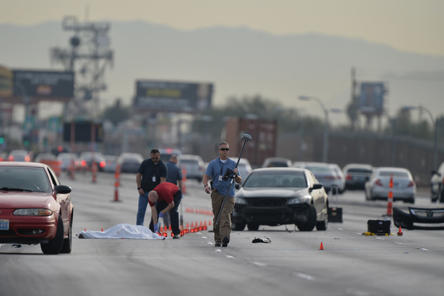 Police investigate the scene of a fatal wreck involving a motorcycle on Tropicana Avenue near Koval Lane on Thursday, Mar. 3, 2016. Brett Le Blanc/Las Vegas Review-Journal Follow @bleblancphoto