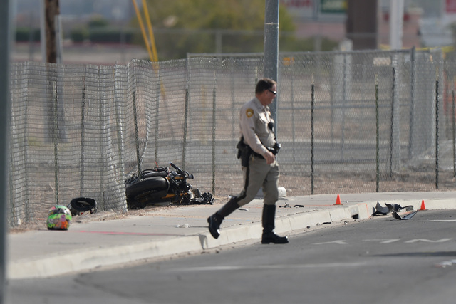 A police officer walks away from a motorcycle involved in a  fatal accident during on Tropicana Avenue near Koval Lane on Thursday, Mar. 3, 2016. Brett Le Blanc/Las Vegas Review-Journal Follow @bl ...