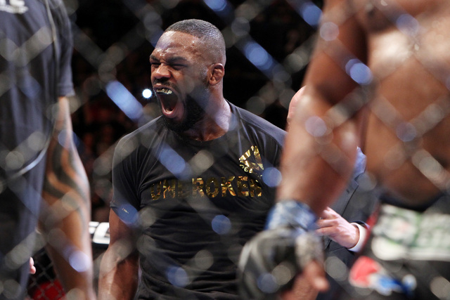 Jon Jones celebrates his victory over Daniel Cormier after their fight at UFC 182 Saturday, Jan. 3, 2015 at the MGM Grand Garden Arena. Jones won a unanimous decision. (Sam Morris/Las Vegas Review ...