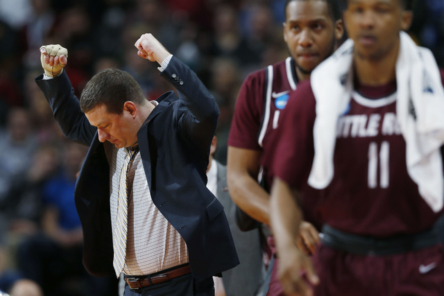 Arkansas Little Rock head coach Chris Beard reacts after his team draws a foul against Iowa State during the first half of a second-round men's college basketball game Saturday, March 19, 2016, in ...