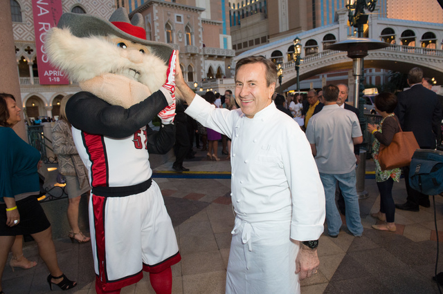 Chef Daniel Boulud, shown high-fiving UNLV mascot Hey Reb, received the prestigious Dom Perignon Award of Excellence during UNLVino's Bubble-Licious at The Venetian April 16, 2015.  (Special to  ...