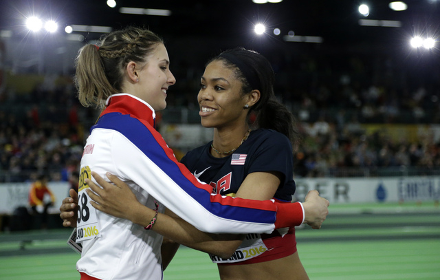 United States' Vashti Cunningham, right, is hugged by Britain's Isobel Pooley after Cunningham won the women's high jump final during the World Indoor Athletics Championships, Sunday, March 20, 20 ...