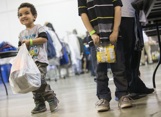William Lisbon, 3, is all smiles after checking out with food and new cloths during the 13th annual U.S. Vets-Las Vegas stand-down event at the Cashman Center, Wednesday, March 16, 2016, in Las Ve ...