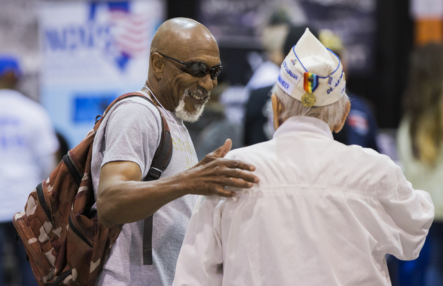 Veteran Ronald Pain, left, shares a laugh with Louis Augenblick, commander of the department of Jewish war veterans, during the 13th annual U.S. Vets-Las Vegas stand-down event at the Cashman Cent ...