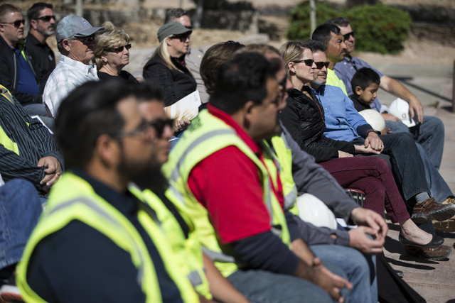 People listen during a national tribute ceremony honoring veterans at the Las Vegas Veterans Memorial outside of the Grant Sawyer State Office Building on Saturday, March 12, 2016, in Las Vegas. E ...