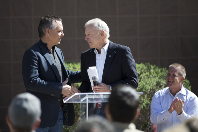 Hugh Sinnock, right, vice president of customer experience at the Las Vegas Convention and Visitors Authority, shakes his with Alan Schrimpf, member of the Las Vegas Veterans Memorial Board of Dir ...