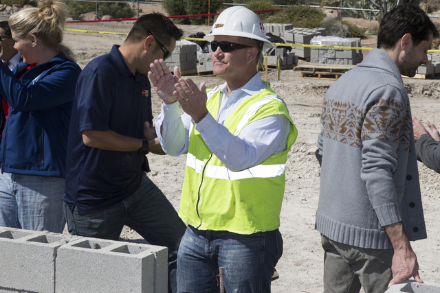 Lt. Gov. Mark Hutchison claps after laying down a brick during a national tribute ceremony honoring veterans at the Las Vegas Veterans Memorial outside of the Grant Sawyer State Office Building on ...