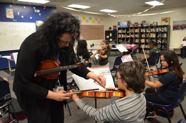 Tianna Harjo works with violin students in a class at the Lied Boys & Girls Club March 1. Ginger Meurer/Special to View