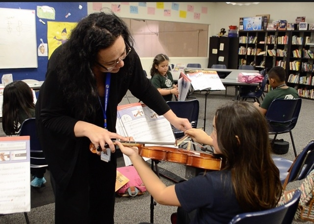 Tianna Harjo,  a substitute viola player for the Las Vegas Philharmonic, works with violin students in a class at the Lied Boys & Girls Club, 2850 Lindell Road, March 1. Ginger Meurer/Special  ...