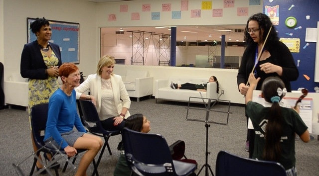 From left, Michelle Sanders and Beverly Rogers of The Rogers Foundation and Amy Wiles, of the Las Vegas Philharmonic, watch Tianna Harjo work with violin students in a class at the Lied Boys & ...