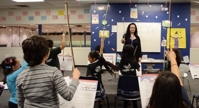 Tianna Harjo leads her violin students at the Lied Boys & Girls Club through a bow exercise. Ginger Meurer/Special to View