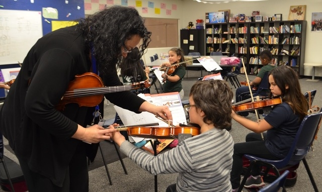 Tianna Harjo takes time to work individually with each violin student at the Lied Boys & Girls Club. Ginger Meurer/Special to View