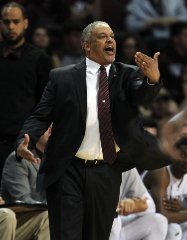 New Mexico State coach Marvin Menzies talks to his team during the first half of an NCAA college basketball game against Cal State Bakersfield in the finals of the Western Athletic Conference men' ...