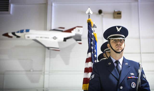 Senior Airman Christian Peterson with the Nellis Air Force Base Honor Guard stands during the U.S. Air Force Warfare Center  change of command ceremony at Nellis Air Base on Tuesday, March 22, 201 ...