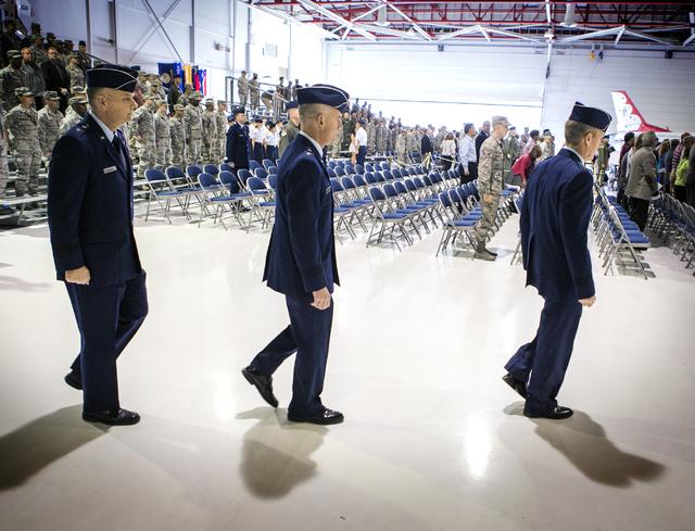 Brig. Gen. Glen D. VanHerck, left, incoming commander of the U.S. Warfare Center, Gen. Jay Silveria, outgoing commander, and Gen. Hawk Carlisle,  commander of Air Combat Command, enter the Thunder ...
