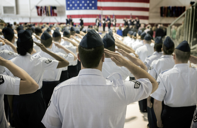 Members of the Air Force Warfare Center salute during  the U.S. Warfare Center change of command ceremony, at Nellis Air Base on Tuesday, March 22, 2016. Jeff Scheid/Las Vegas Review-Journal Follo ...