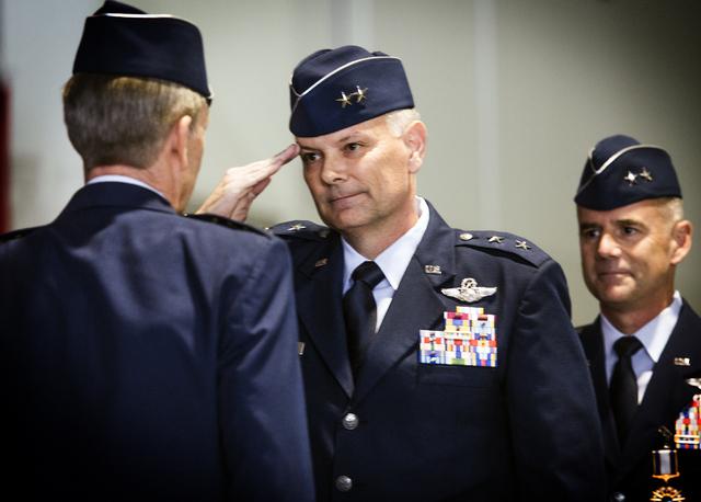 Brig. Gen. Glen D. VanHerck, center, incoming commander of the United States Warfare Center, salutes Gen. Hawk Carlisle, left, commander of Air Combat Command, during a change of command ceremony  ...