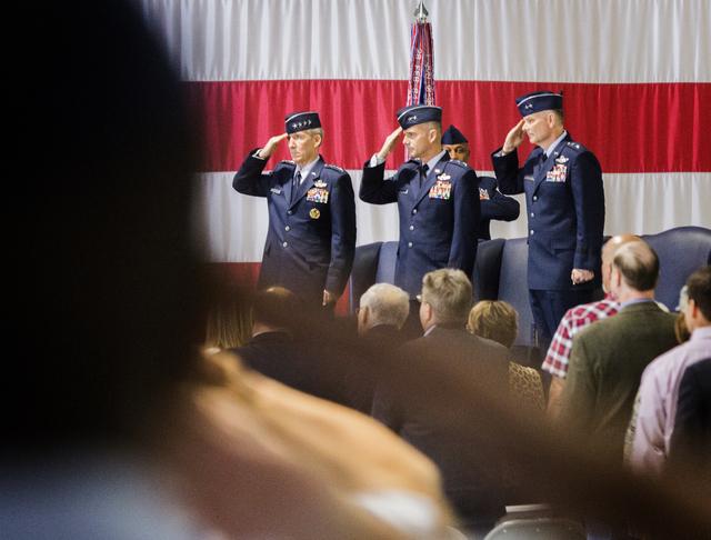 Gen. Hawk Carlisle, left, commander of Air Combat Command, Gen. Jay Silveria, outgoing commander of the U. S. Warfare Center, and Brig. Gen. Glen D. VanHerck, incoming commander during a change of ...