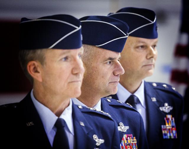 Gen. Hawk Carlisle, left, commander of Air Combat Command, Gen. Jay Silveria, outgoing commander of the United States Warfare Center, and Brig. Gen. Glen D. VanHerck, incoming commander, during a  ...