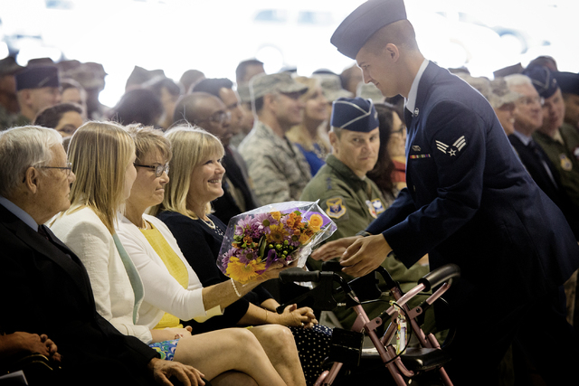 An airman gives Marilyn VanHerck, wife of Brig. Gen. Glen D. VanHerck, flowers during the U.S. Warfare Center change of command  ceremony at  Nellis Air Base United States Warfare Center, on Tuesd ...