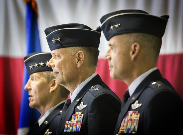 Gen. Hawk Carlisle, left, commander of Air Combat Command, Brig. Gen. Glen D. VanHerck, incoming commander United States Warfare Center, and Gen. Jay Silveria, outgoing commander, during a change  ...