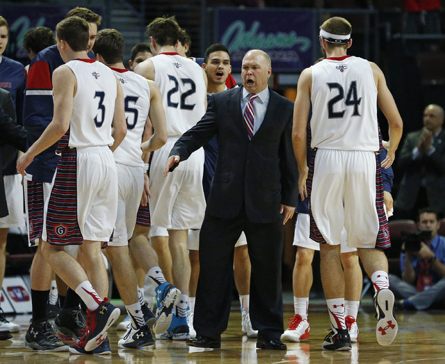 Saint Mary's head coach Randy Bennett, center right, yells at his team during the first half of a West Coast Conference tournament NCAA college basketball game against Pepperdine Monday, March 7,  ...