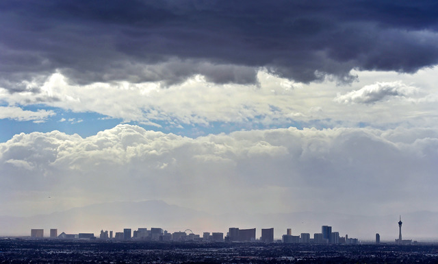 Dark clouds hang over the Las Vegas skyline on Monday, March 28, 2016, as seen from East Washington Avenue near North Hollywood Boulevard in Las Vegas. Tuesday will be cooler than normal, breezy a ...