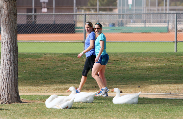 Kerrie Cathcart, left, and her sister Kim Howell walk on a sunny morning at Sunset Park Monday, March, 14, 2016, in Las Vegas. The Las Vegas Valley can expect to see sunny skies and warm temperatu ...