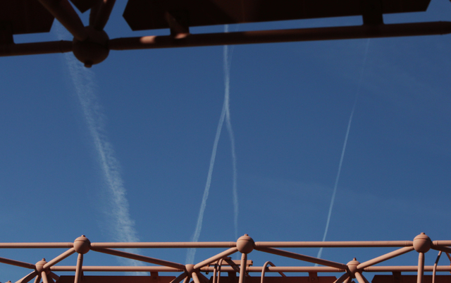 Jets flying through the blue sky leave trails of smoke behind them as they fly over Las Vegas Wednesday, March 16, 2016. Wednesdayճ skies are expected to be mostly clear, but there is a chance of ...