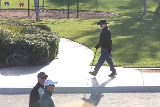 James Carlisle of Henderson, right, walks on a warm sunny morning at Vivaldi Park Tuesday, March 8, 2016, in Henderson. Bizuayehu Tesfaye/Las Vegas Review-Journal Follow @bizutesfaye