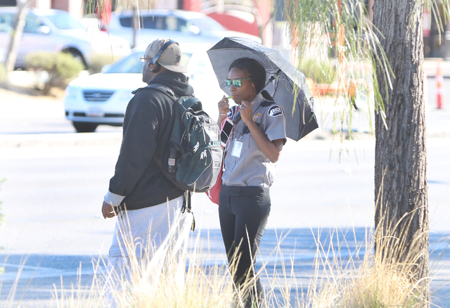 A commuter holds her umbrella to protect herself from sun as she waits for a bus on Tropicana Avenue Wednesday March 9, 2016, in Las Vegas. (Bizuayehu Tesfaye/Las Vegas Review-Journal) Follow @biz ...