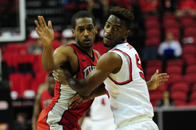 UNLV guard Barry Cheaney guards Fresno State guard Jahmel Taylor in the first half of their Mountain West Conference semifinal basketball game at the Thomas & Mack Center in Las Vegas Thursday ...