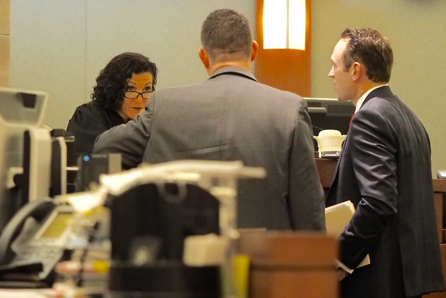 Judge Holly Stoberski listens to the prosecutor, center, and defense attorney Warren Geller, right, in the Jillian Lafave case at the Regional Justice Center in Las Vegas on Wednesday, March 30, 2 ...