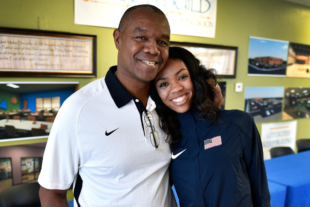Bishop Gorman high jumper Vashti Cunningham of Las Vegas, right, poses with her father, former UNLV and NFL quarterback Randall Cunningham, at a news conference announcing she will turn profession ...