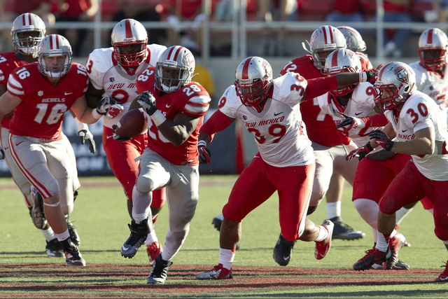 UNLV running back Bradley Randle (28) runs the ball against New Mexico on November 3, 2012. Randle is among the former UNLV players hoping to catch someone's eye on Pro Day Thursday at the Lied At ...