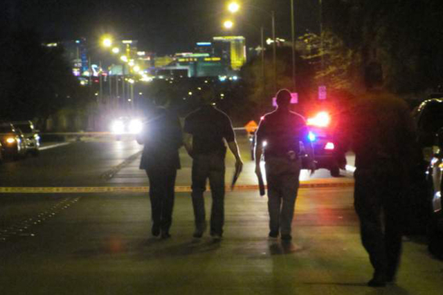 Las Vegas police officers walk north on Haven Street during an investigation of an officer-involved shooting in the far south valley on Monday, Feb. 29, 2016. Streets were closed near Stimuli Stre ...