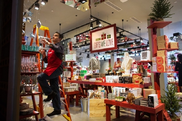 """David Henault (cq) finishes hanging a display inside The Tree Lot at Crate and Barrel, a temporary holiday store by the retailer, Tuesday, Oct. 29, 2013 at Town Square. The """"pop-up shop"""" will be o ..."""