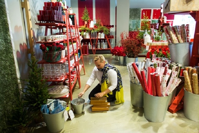 Gretchen Zuk (cq) stocks jingle bell napkin rings inside The Tree Lot at Crate and Barrel, a temporary holiday store by the retailer, Tuesday, Oct. 29, 2013 at Town Square. (Samantha Clemens/Las V ...