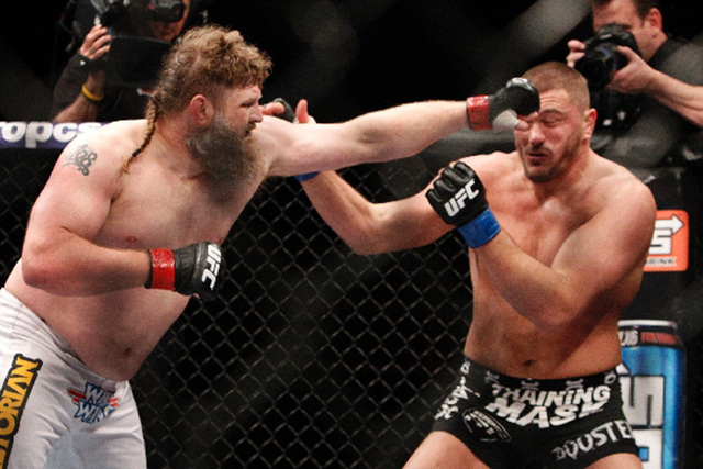Matt Mitrione, right, absorbing a punch from Roy Nelson during The Ultimate Fighter 16 finale at the Hard Rock Hotel on Dec. 15, was suspended by the UFC on Monday while it investigates comments M ...