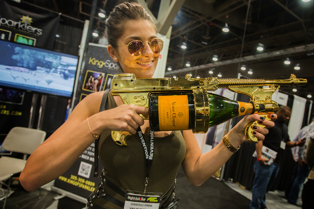 Christelle Candia holds the King of Sparkers champagne spray gun at the Nightclub & Bar Convention & Trade Show in the Las Vegas Convention Center on Tuesday,  March 8, 2016. Jeff Scheid/L ...