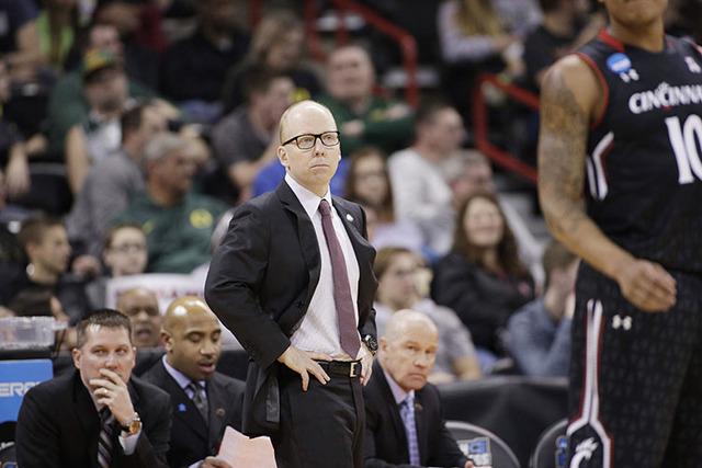 Cincinnati head coach Mick Cronin watches during the first half of a first-round men's college basketball game against Saint Joseph's in the NCAA Tournament in Spokane, Wash., Friday, March 18, 20 ...