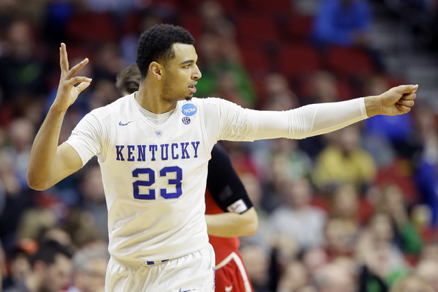 Kentucky guard Jamal Murray reacts after making a 3-point basket during the second half of a first-round men's college basketball game against Stony Brook in the NCAA Tournament, Thursday, March 1 ...